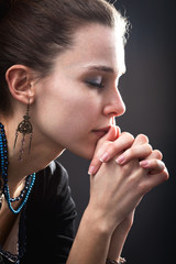 Religion concept - woman and her prayer