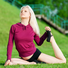 Beautiful woman doing yoga stretching exercise