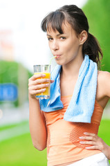 Girl drinking juice after exercise