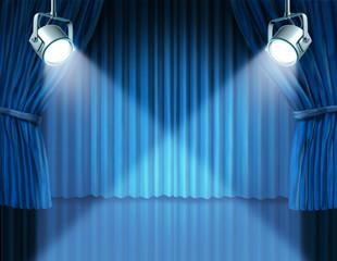 Spotlights on blue velvet cinema curtains
