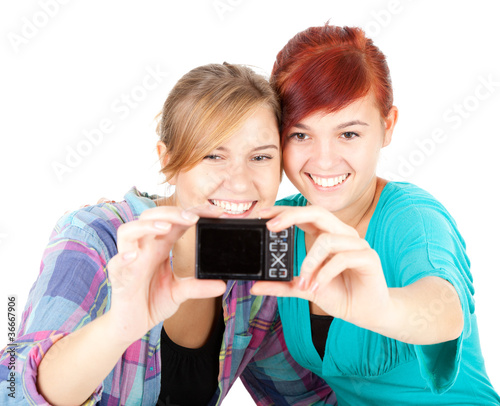 girlfriends taking picture of themselves, white background