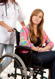 woman doctor or nurse wiht patient on a wheelchair