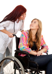 woman doctor or nurse with patient on a wheelchair