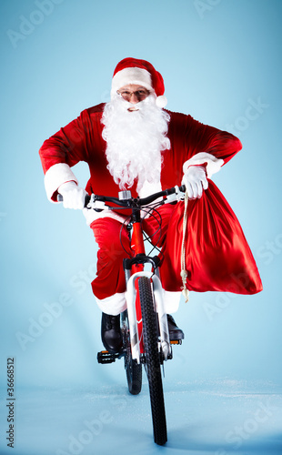 Santa on bicycle