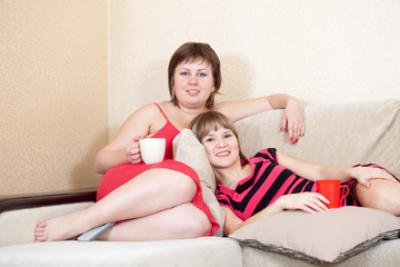 Relaxed women lying on sofa