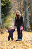 Mother and daughter in an autumnal park