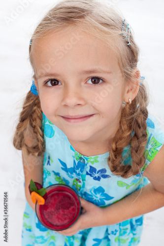 Little girl with fresh juice - top view