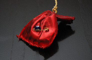 gift with amulet, nazar eye