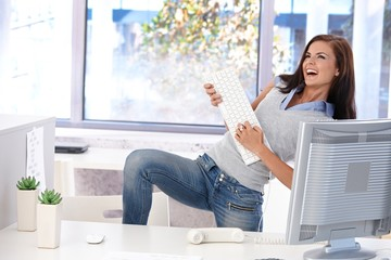 Young woman having fun in bright office