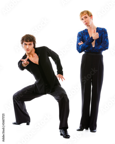 Male dancer showing thumbs up while friend making dance pose
