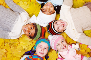 children on autumnal leaves