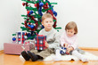 Small children sit at a New Year tree