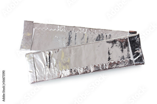two chewing gums wrapped in standard silver foil, isolated