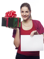 Pretty young woman with present holding empty blank