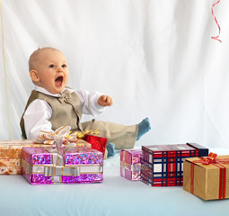 One year old baby with gifts. Day of birth.
