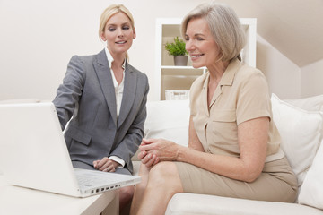 Saleswoman Advising a Senior Woman on Laptop Computer