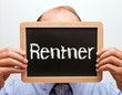 Rentner - Senior mit Kreide Tafel