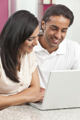 Asian Indian Man & Woman Couple Using Laptop Computer