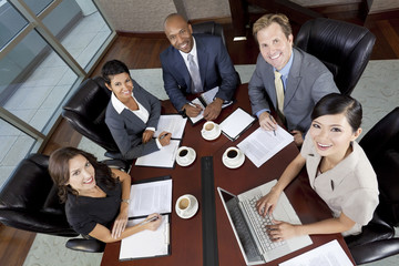 Interracial Men & Women Business Team Meeting in Boardroom