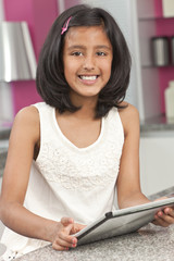 Asian Indian Girl Child Using Tablet Computer at Home