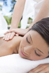 Woman Relaxing At Health Spa Having Outdoor Massage