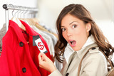 shopping woman shocked over expensive price - 36691956