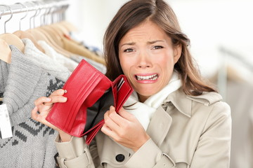 empty wallet - woman with no money shopping