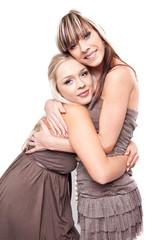 Two beautiful caucasian sisters hugging