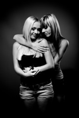 black and white photo of two sexy girls hugging