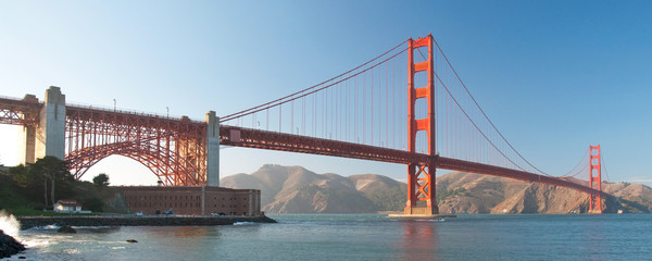 The Golden Gate Bridge in San Francisco during the sunset panora