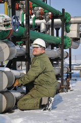 Worker in the oil and gas collector