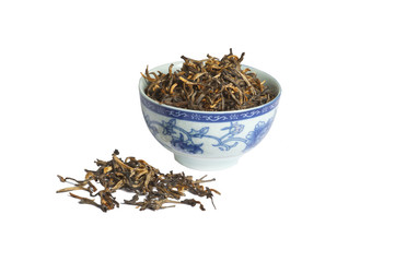 Black tea loose dried tea leaves in  bowl, isolated