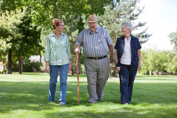 Senior Friends Walking in Park