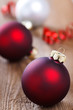 christmas baubles on wooden board