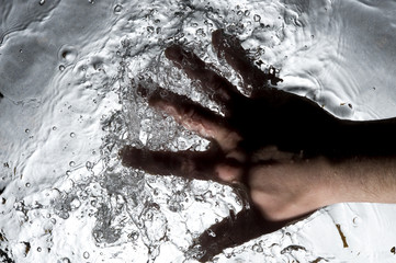 Hand on the black water