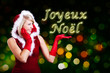 Miss Santa showing Joyeux Noël