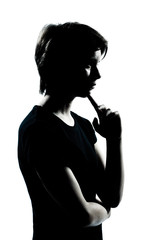 one young teenager boy or girl silhouette thinking