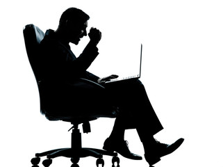 one business man computer computing success sitting in armchair