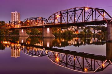 Bridge reflecting in calm River