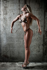 Young sexy muscular woman