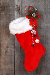 Christmas sock and decoration on wood