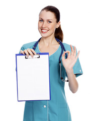 Smiling female doctor holding a clipboard against white backgrou