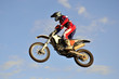 motocross rider on a motorcycle flying through the air