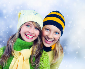 Winter Teenage Girls outdoors. Holidays. Happy Teens