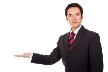 Happy business man presenting against white background