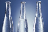 transparent bottles on blue background