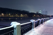 Quay of Moskva river and view of  Moscow City complex at night