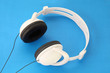 White Stereo Headset with black stars and wire on blue