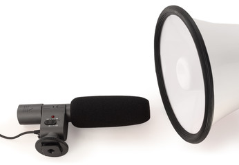 Handheld megaphone and big black microphone on white