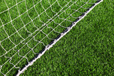 net for football lying on artificial grass of football field poster